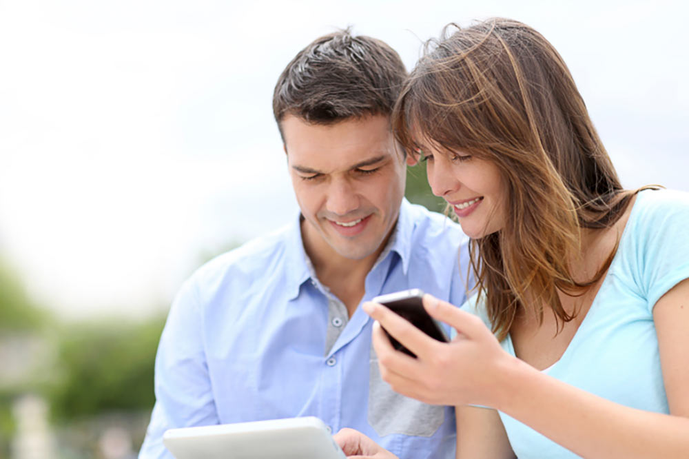 Couple with phone and tablet